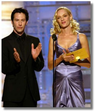 Actors Keanu Reeves (looking smashing in all black) and Uma Thurman (wow, do you have to have the perfect body to wear that dress or what?) serve as presenters during the 61st annual Golden Globe Awards in Beverly Hills January 25, 2004. REUTERS/Chris Haston/NBC/Handout