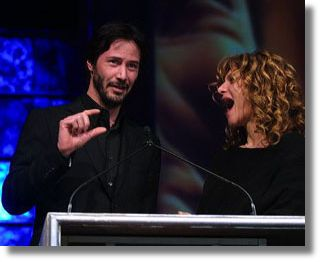 Keanu and Amy Pascal, chairman of Sony's Columbia Pictures at ShoWest 2004 - Photo by Ryan Miller