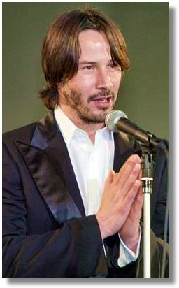 Hollywood star Keanu Reeves clasps his hands to thank for Japanese fans gathered for the premier of his latest film 'The Matrix Reloaded' in Tokyo Monday, May 26, 2003. (AP Photo/Shizuo Kambayashi)