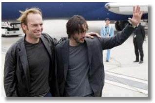 U.S. actor Keanu Reeves and Australian actor Hugo Weaving arrive at the New Tokyo International airport in Narita, east of Tokyo May 23, 2003. Reeves and fellow cast members are in Japan to promote the movie 'Matrix Reloaded', the sequel to 'The Matrix', which was released in 1999. Matrix Reloaded is due for release in Japan on June 7. REUTERS/Issei Kato